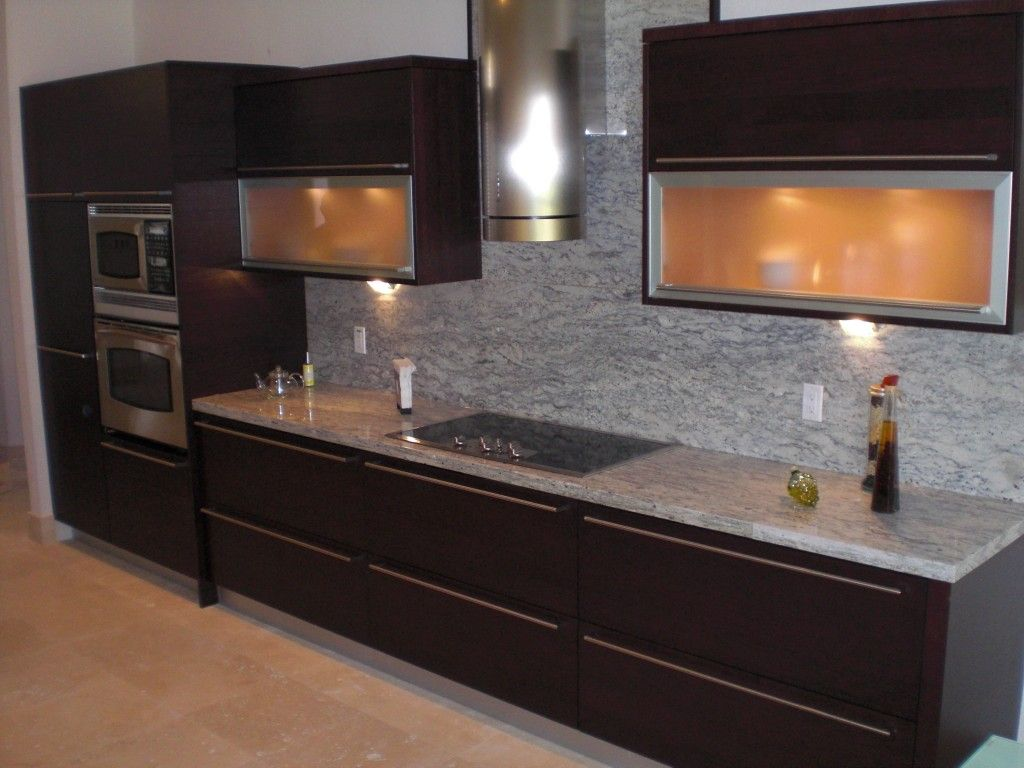 Dark Wood Contemporary Kitchen with marble counter top and backsplash