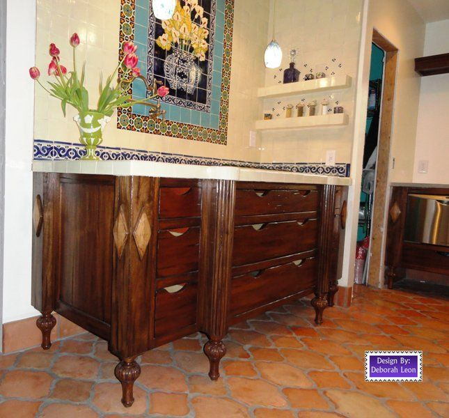 Kitchen stove top with ornate backsplash and carved legs