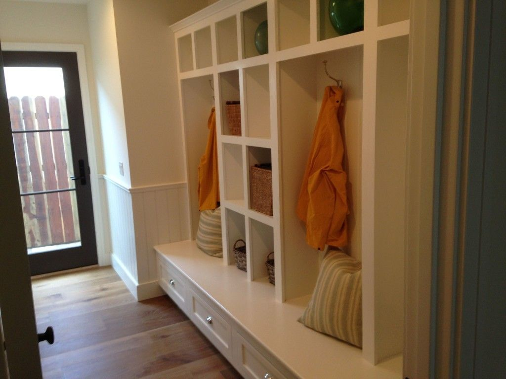 Entry way area with seating and cabinets for coats and shoes