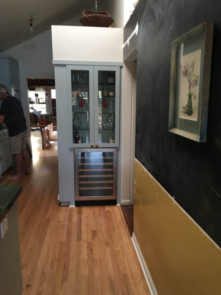 display cabinet with a wine cooler on the bottom.